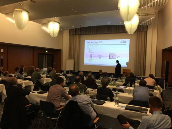 The picture shows Mr. Hänel informing the audience about KNX Secure, IoT and tools.